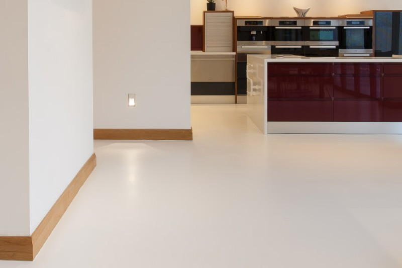 Open plan kitchen with resin flooring